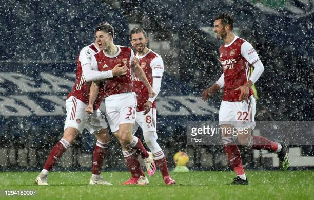 Kieran Tierney of Arsenal celebrates with teammates Rob Holding, Dani Ceballos and Pablo Mari after scoring their team's first goal during the...