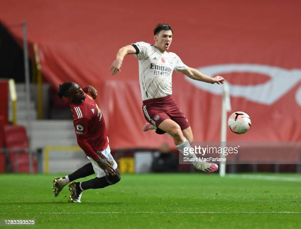 Kieran Tierney of Arsenal challenged by Aaron Wan-Bissaka of Man United during the Premier League match between Manchester United and Arsenal at Old...