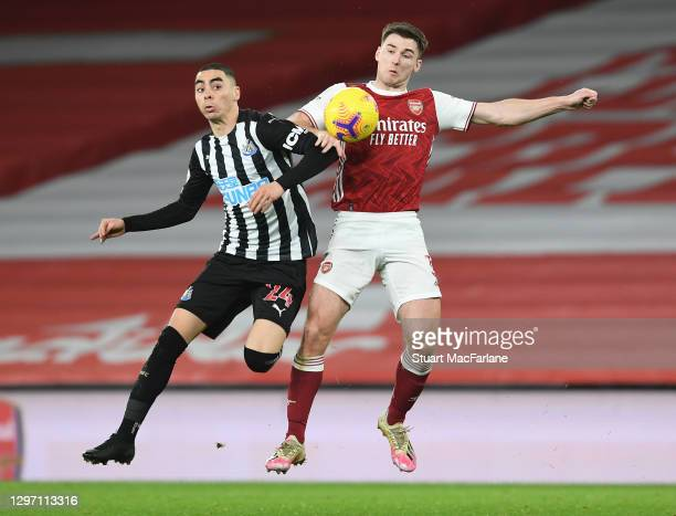 Kieran Tierney of Arsenal challenges Miguel Almiron of Newcastle United during the Premier League match between Arsenal and Newcastle United at...