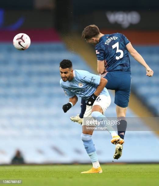 Kieran Tierney of Arsenal heads clear past Riyad Mahrez of Manchester City during the Premier League match between Manchester City and Arsenal at...