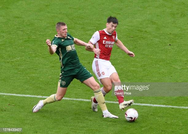 Kieran Tierney of Arsenal is closed down by John Lundstram of Sheffield United during the Premier League match between Arsenal and Sheffield United...