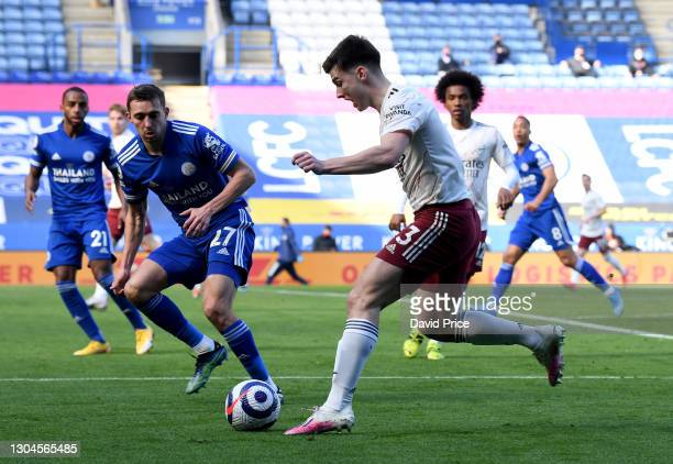 Kieran Tierney of Arsenal is closed down by Timothy Castagne of Leicester during the Premier League match between Leicester City and Arsenal at The...