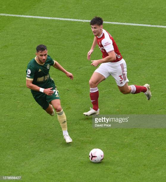 Kieran Tierney of Arsenal knocks the ball past George Baldock of Sheffield United during the Premier League match between Arsenal and Sheffield...