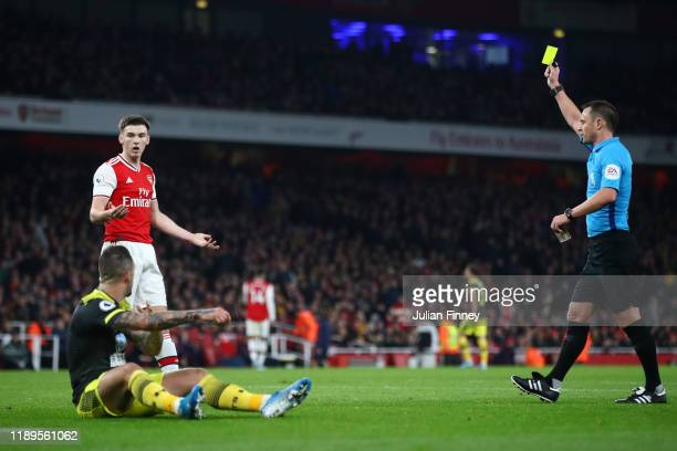 Kieran Tierney of Arsenal reacts after a receiving a yellow card and conceding a penalty for a foul on Danny Ings of Southampton during the Premier...