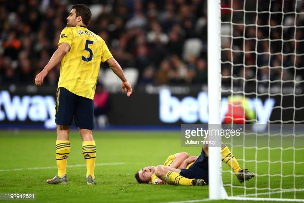 Kieran Tierney of Arsenal reacts following an injury during the Premier League match between West Ham United and Arsenal FC at London Stadium on...