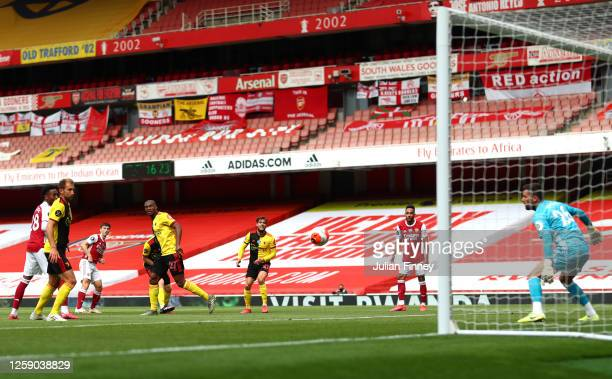 Kieran Tierney of Arsenal scores his sides second goal during the Premier League match between Arsenal FC and Watford FC at Emirates Stadium on July...