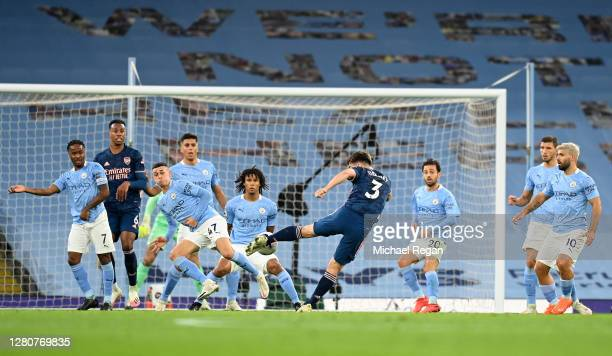 Kieran Tierney of Arsenal takes a shot during the Premier League match between Manchester City and Arsenal at Etihad Stadium on October 17 2020 in...