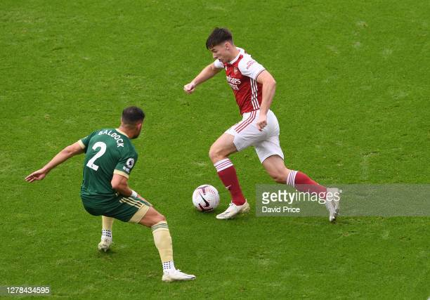 Kieran Tierney of Arsenal takes on George Baldock of Sheffield United during the Premier League match between Arsenal and Sheffield United at...