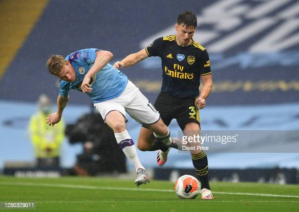 Kieran Tierney of Arsenal takes on Kevin De Bruyne of Man City during the Premier League match between Manchester City and Arsenal FC at Etihad...