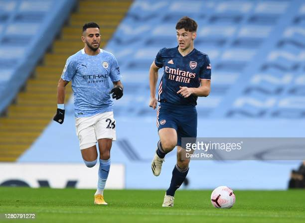 Kieran Tierney of Arsenal takes on Riyad Mahrez of Man City during the Premier League match between Manchester City and Arsenal at Etihad Stadium on...