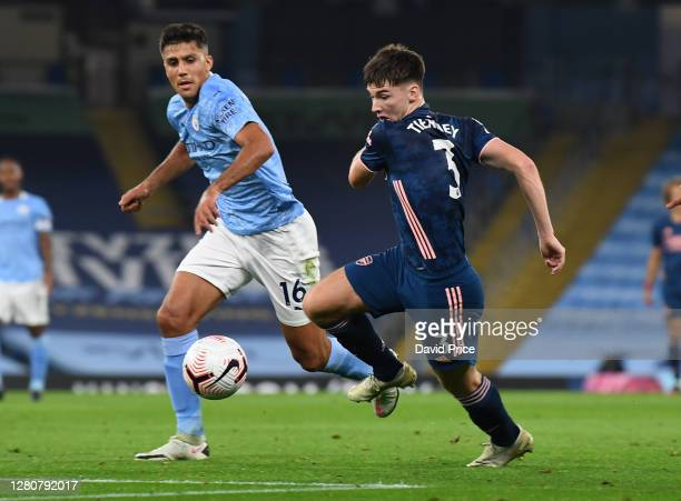 Kieran Tierney of Arsenal takes on Rodrigo of Man City during the Premier League match between Manchester City and Arsenal at Etihad Stadium on...