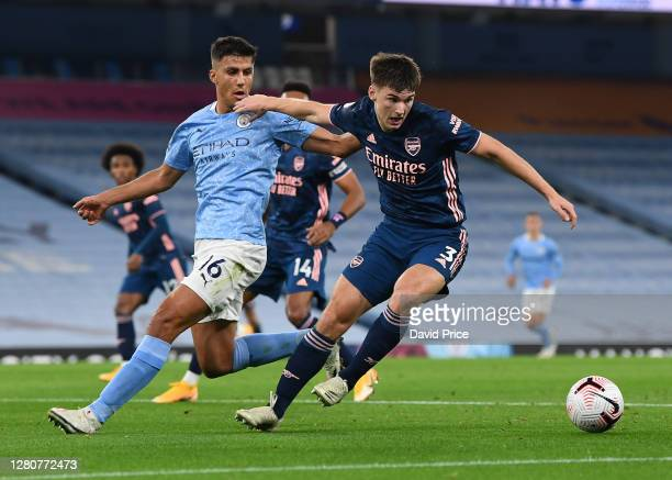 Kieran Tierney of Arsenal turns away from Rodrigo of Man City during the Premier League match between Manchester City and Arsenal at Etihad Stadium...
