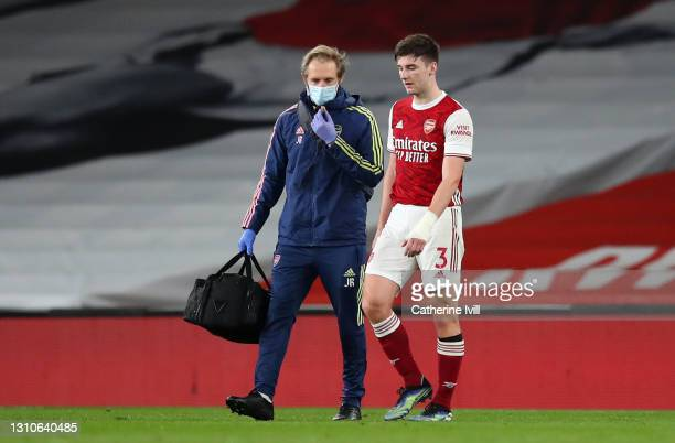 Kieran Tierney of Arsenal walks off the pitch after picking up an injury during the Premier League match between Arsenal and Liverpool at Emirates...
