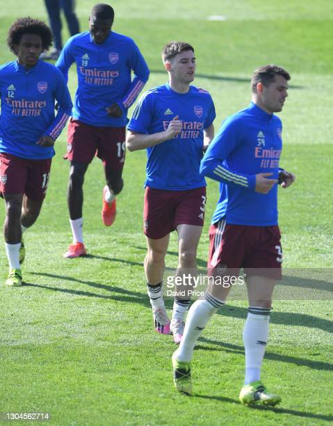 Kieran Tierney of Arsenal warms up before the Premier League match between Leicester City and Arsenal at The King Power Stadium on February 28, 2021...