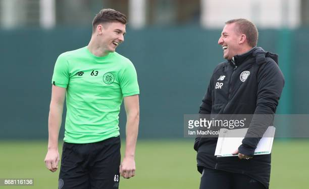 Kieran Tierney of Celtic and Brendan Rodgers manager of Celtic share a joke as they walk out prior to the Celtic Training Session prior to the Group...