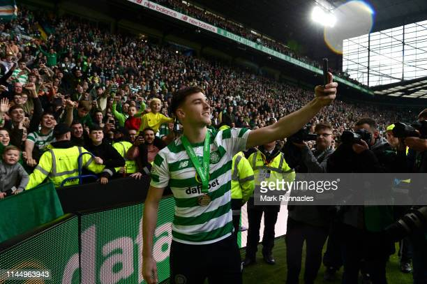 Kieran Tierney of Celtic takes a selfie with the Celtic fans during the Ladbrokes Scottish Premiership match between Celtic FC and Heart of...