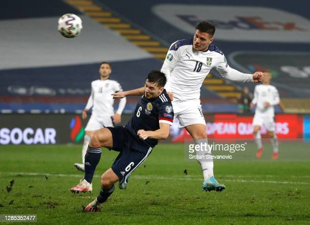 Kieran Tierney of Scotland collides with Luka Jovic of Serbia during the UEFA EURO 2020 Play-Off Final between Serbia and Scotland at Rajko Mitic...