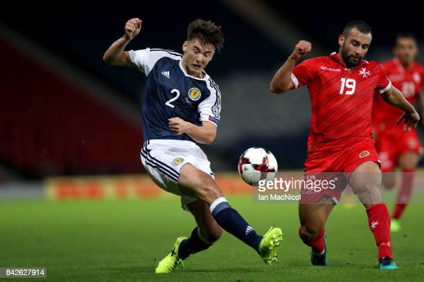 Kieran Tierney of Scotland crosses the ball as Joseph Zerafa of Malta attempts to block during the FIFA 2018 World Cup Qualifier between Scotland and...