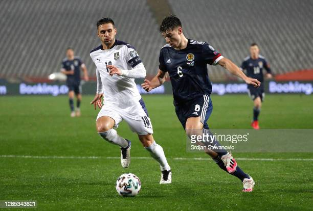 Kieran Tierney of Scotland looks to break past Dusan Tadic of Serbia during the UEFA EURO 2020 Play-Off Final between Serbia and Scotland at Rajko...