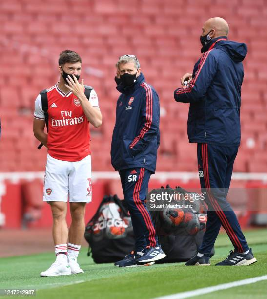 Kieran Tierney with Arsenal coaches Steve Round and Steve Bould before a friendly match between Arsenal and Charlton Athletic at Emirates Stadium on...