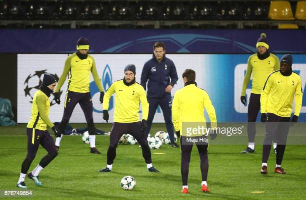 Kieran Trippier and Christian Eriksen of Tottenham Hotspur take part during a Tottenham Hotspur training session ahead of the Chamions League Group H...