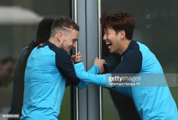 Kieran Trippier and HeungMin Son of Tottenham Hotspur share a joke during a Tottenham Hotspur training session at the Tottenham Hotspur training...