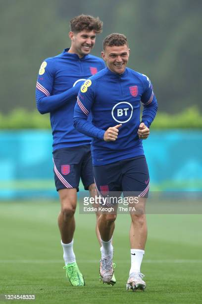 Kieran Trippier and John Stones of England in action during the England Training Session at Tottenham Hotspur Training Ground on June 20, 2021 in...