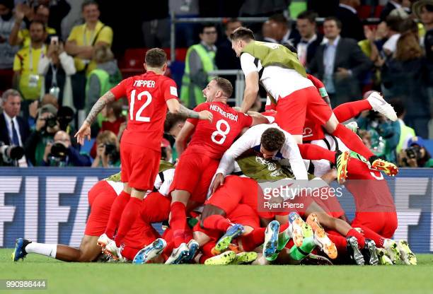 Kieran Trippier and Jordan Henderson of England celebrate victory with team mates after the 2018 FIFA World Cup Russia Round of 16 match between...