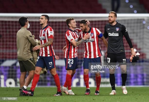 Kieran Trippier and Koke of Atletico de Madrid celebrate at the end of the La Liga Santander match between Atletico de Madrid and Real Sociedad at...