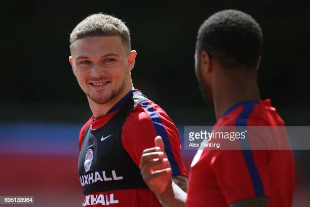 Kieran Trippier chats with teamate Raheem Sterling during the England training session at the Chemin De Ronde Stadium on June 12 2017 in...