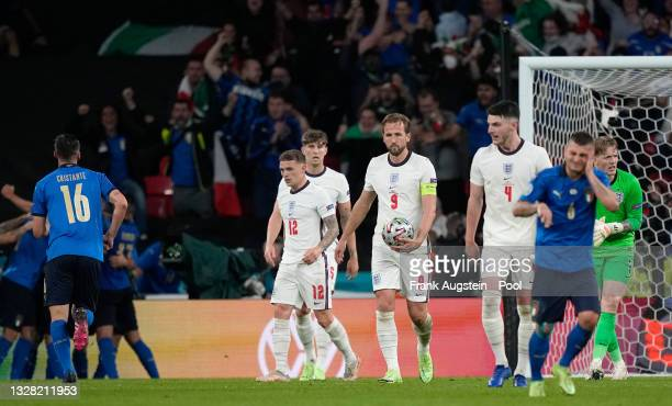 Kieran Trippier, John Stones, Harry Kane and Declan Rice of England look dejected after conceding their side's first goal scored by Leonardo Bonucci...