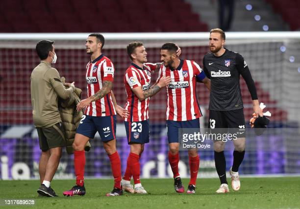Kieran Trippier of Atletico celebrates with Koke of Atletico Madrid during the La Liga Santander match between Atletico de Madrid and Real Sociedad...