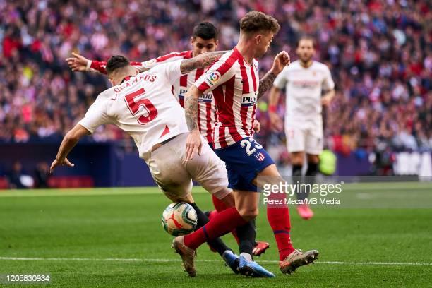 Kieran Trippier of Atletico de Madrid and Lucas Ocampos of Sevilla during the Liga match between Club Atletico de Madrid and Sevilla FC at Wanda...