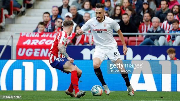 Kieran Trippier of Atletico de Madrid Lucas Ocampos of Sevilla FC battle for the ball during the Liga match between Club Atletico de Madrid and...