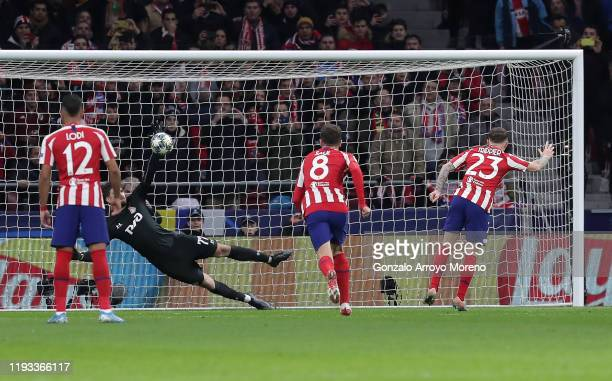 Kieran Trippier of Atletico Madrid has his penalty shot saved by Anton Kochenkov of Lokomotiv Moscow during the UEFA Champions League group D match...