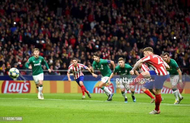 Kieran Trippier of Atletico Madrid takes a penalty kick which is saved by Anton Kochenkov of Lokomotiv Moscow during the UEFA Champions League group...