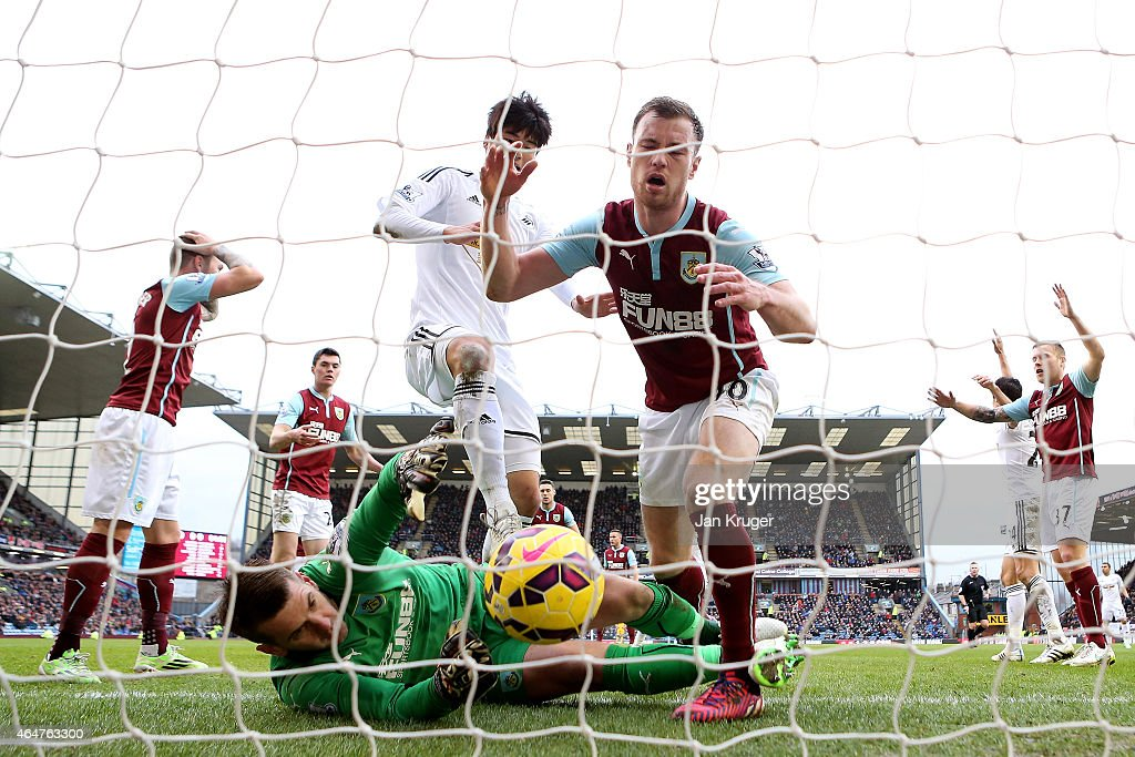 Kieran Trippier #2 ( L) of Burnley scores an own goal past goalkeeper Thomas Heaton of Burnley during the Barclays Premier League match between Burnley and Swansea City at Turf Moor on February 28, 2015 in Burnley, England.