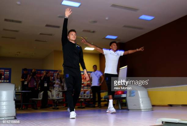 Kieran Trippier of England and Jesse Lingard of England celebrate during a game of bowling during the England media access at Spartak Zelenogorsk...