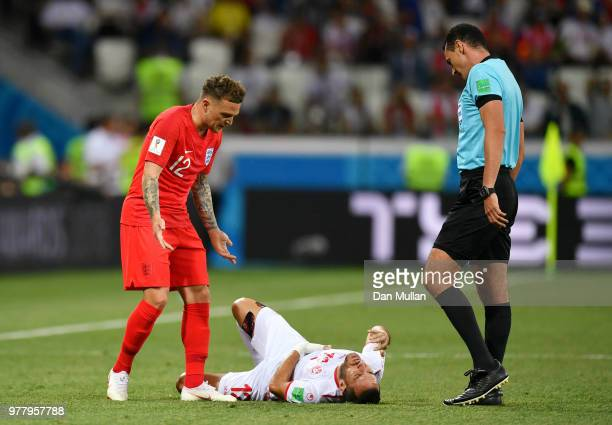 Kieran Trippier of England argeus with Referee Wilmar Roldan while Ali Maaloul of Tunisia lies injured during the 2018 FIFA World Cup Russia group G...