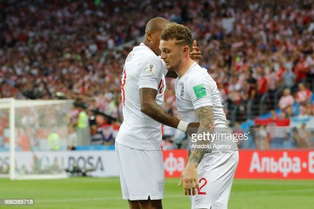 Kieran Trippier of England celebrates with his teammate Ashley Young after scoring a goal during the 2018 FIFA World Cup Russia semi final match...