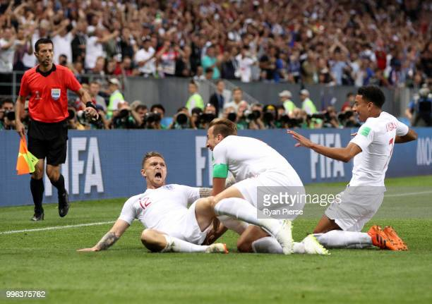 Kieran Trippier of England celebrates with team mates Harry Kane and Jesse Lingard after scoring his team's first goal during the 2018 FIFA World Cup...