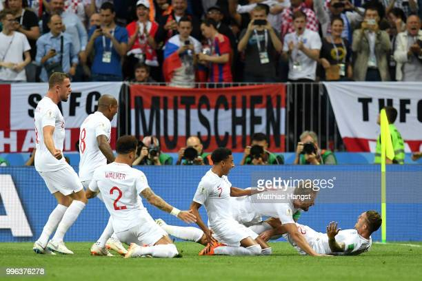 Kieran Trippier of England celebrates with teammates after scoring his team's first goal during the 2018 FIFA World Cup Russia Semi Final match...