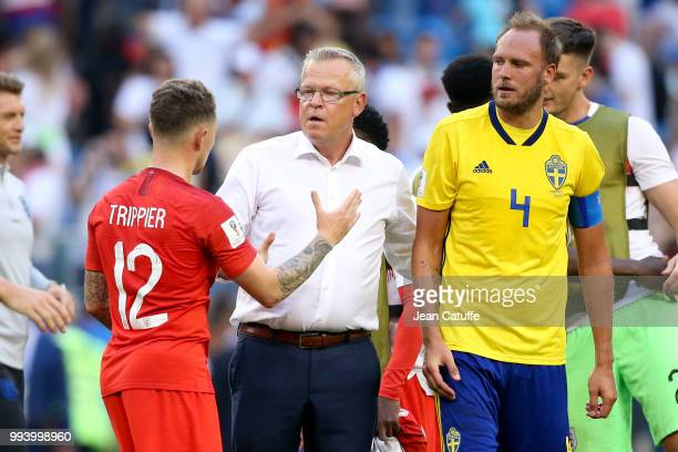 Kieran Trippier of England greets coach of Sweden Janne Andersson while Andreas Granqvist of Sweden looks on following the 2018 FIFA World Cup Russia...