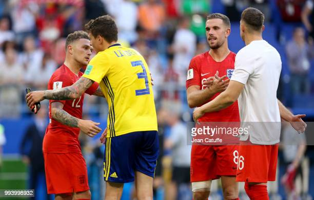 Kieran Trippier of England greets Victor Lindelof of Sweden while Jordan Henderson greets Phil Jones of England following the 2018 FIFA World Cup...