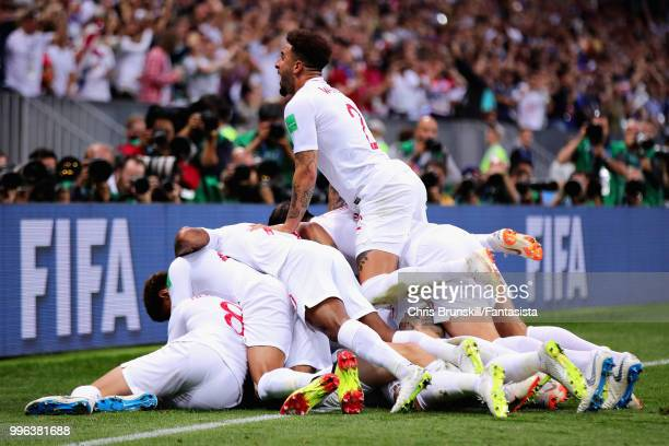 Kieran Trippier of England is mobbed by his team as he celebrates scoring his sides first goal during the 2018 FIFA World Cup Russia Semi Final match...