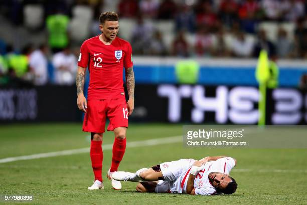 Kieran Trippier of England looks on as Ali Maaloul of Tunisia rolls on the floor during the 2018 FIFA World Cup Russia group G match between Tunisia...