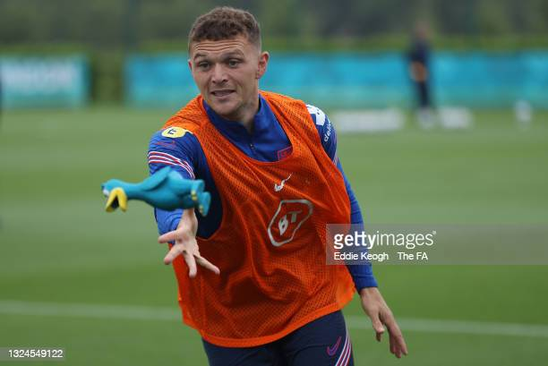 Kieran Trippier of England plays tag with teammates using a rubber duck during the England Training Session at Tottenham Hotspur Training Ground on...