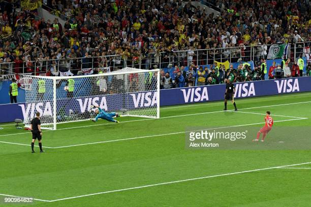 Kieran Trippier of England scores his team's fourth penalty in the penalty shoot out during the 2018 FIFA World Cup Russia Round of 16 match between...
