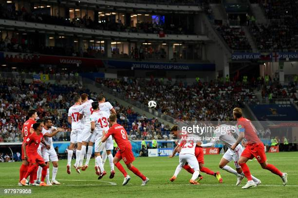 Kieran Trippier of England shoots a free kick over Tunisia's wall during the 2018 FIFA World Cup Russia group G match between Tunisia and England at...