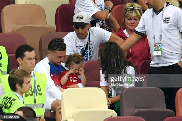 Kieran Trippier of England speaks with his family following England's defeat in the 2018 FIFA World Cup Russia Semi Final match between England and...